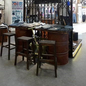 Lee Cooper in China :: retailing design and visual merchandising all shops props :: vintage oil tanks