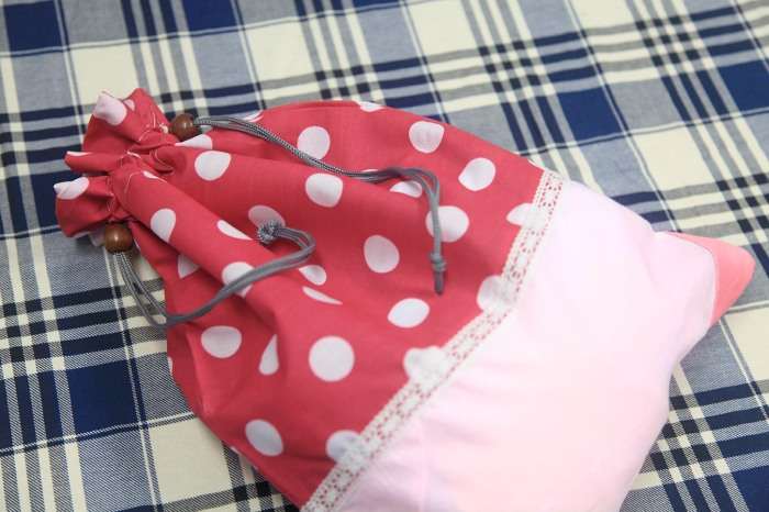 Green Baby Garden upcycling clothing bag with contents