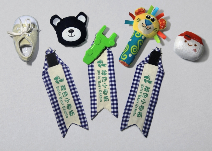 Green Baby Garden upcycling uniform identity brooch using babies' merchandises as a very strong identity