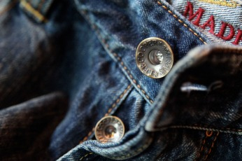 jeans close up photography on front opening brass buttons | Lee Cooper in China :: retailing packaging design for new premium jeans