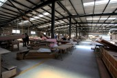 whole wood work cabin, machinery, workers, cutting wood pieces, raw material | Leading Retail Renovation Brand – HTHY Group :: Photography of Factory for brand book