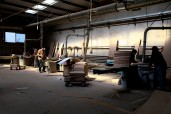 machinery workers cutting wood pieces, raw material | Leading Retail Renovation Brand – HTHY Group :: Photography of Factory for brand book