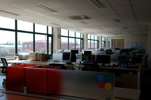 back office, rows of staff desks, with HTHY identity stickers on partition | Leading Retail Renovation Brand – HTHY Group :: Photography of Factory for brand book