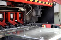 metal machinery close up bending cutting in Beijing factory   Leading Retail Renovation Brand – HTHY Group :: Photography of Factory for brand book