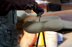 worker smoothing paints of furniture | Leading Retail Renovation Brand – HTHY Group :: Photography of Factory for brand book