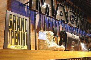 black raw steel POP stand, in use on shoes shelf | British Fashion Retail Brand – Magnum London :: Visual Merchandising