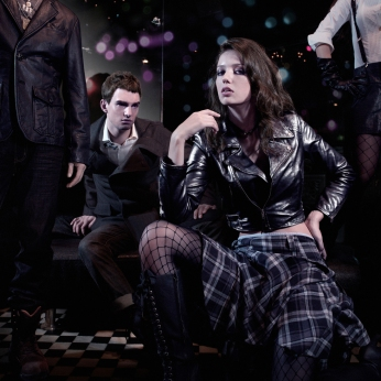 menwear womenswear, black leather biker jacket grey checkers dress, black jacket grey pants | Magnum London :: 2008 FW collection lookbook
