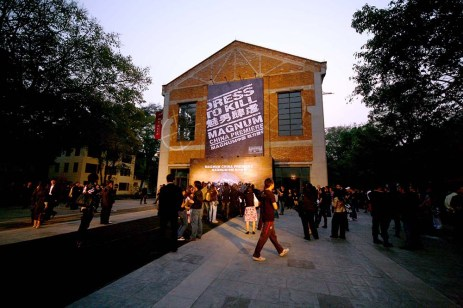 guests assembly square outside event venue at sunset | British Fashion Retail Brand - Magnum London :: China premiere fashion show 2007