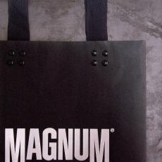 medium size paper black shopping bag, retailing packaging | Magnum Essential Equipment :: branding identity design
