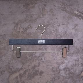 retail pants hanger metallic foil logo on black wood, new identity | British Tactical Apparel Wholesale Brand – Magnum Essential Equipment :: branding