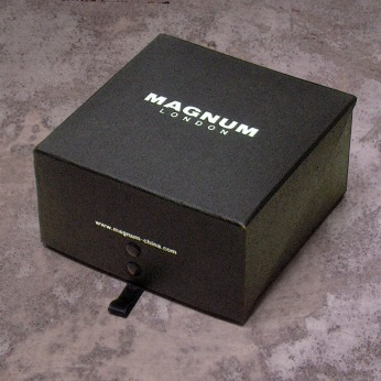 accessories belt box, black cardboard, closed, silver foil logo | British Fashion Retail Brand – Magnum London :: product packaging