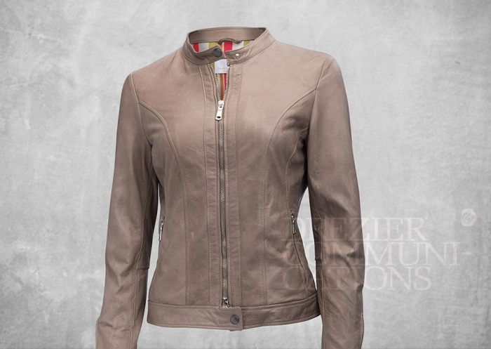 stone brown little stand collar jacket normal body length zipped women's wear on cement background retouched colour managment styling | Garment Merchandising Company in Hong Kong : : Styling and Imaging of Apparel Made in and Imported from Italy Reselling through e-Commerce