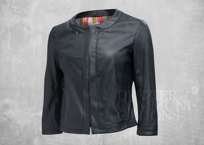 charcoal round neckline jacket short body length 3/4 sleeves buttoned women's wear on cement background retouched colour managment styling | Garment Merchandising Company in Hong Kong : : Styling and Imaging of Apparel Made in and Imported from Italy Reselling through e-Commerce