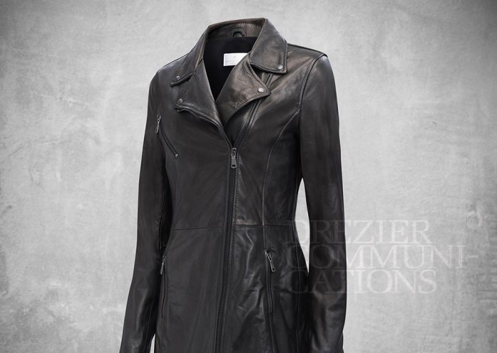 charcoal bike jacket long body zipped women's wear on cement background retouched colour managment styling | Garment Merchandising Company in Hong Kong : : Styling and Imaging of Apparel Made in and Imported from Italy Reselling through e-Commerce