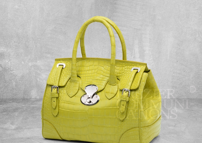 women's lemon yellow hand bag table top, accessories photography on cement background styling art direction retouched colour management | Garment Merchandising Company in Hong Kong : : Styling and Imaging of Apparel Made in and Imported from Italy Reselling through e-Commerce