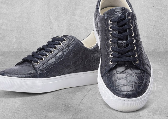 men's causal shoes charcoal pairs table top, accessories photography on cement background styling art direction retouched colour management | Garment Merchandising Company in Hong Kong : : Styling and Imaging of Apparel Made in and Imported from Italy Reselling through e-Commerce