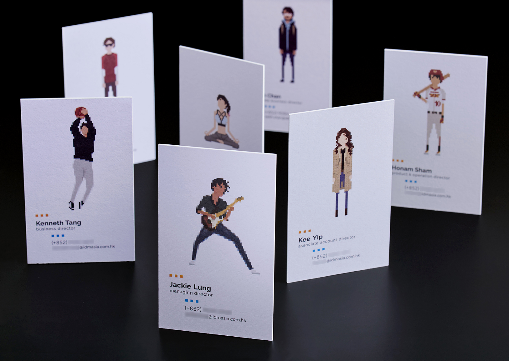 A leading Asian Digital Marketing Agency Brand based in Hong Kong and office in South Korea :: Identity Revamp and New Business Card Design :: business card, name card, 7 executives, standing random, dynamic branding, personalisation pixelated figures of every individuals, black table top, anglar view