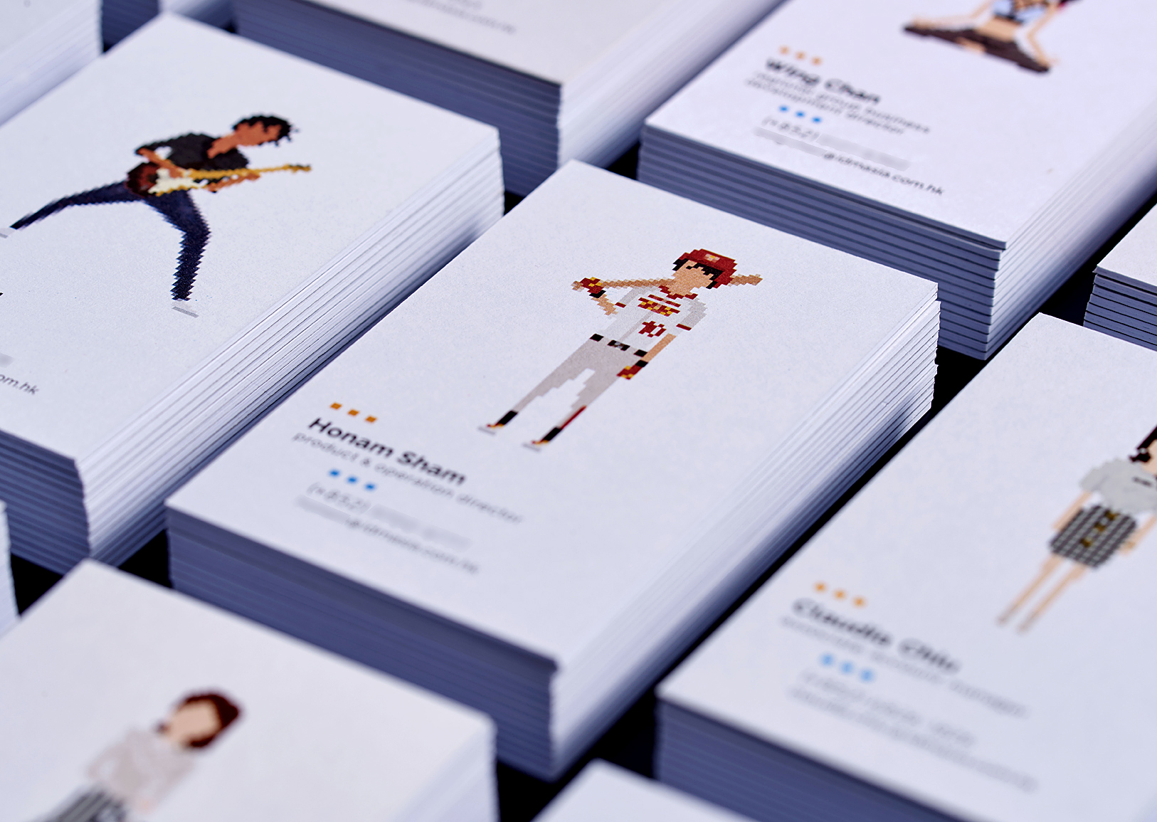 A leading Asian Digital Marketing Agency Brand based in Hong Kong and office in South Korea :: Identity Revamp and New Business Card Design :: business card, name card, 12 decks, 3 x 4 array, dynamic branding, personalisation pixelated figures of every individuals, black table top, focusing HS baseball player, anglar view
